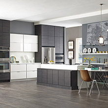 Kitchen cabinets with black and white color blocking