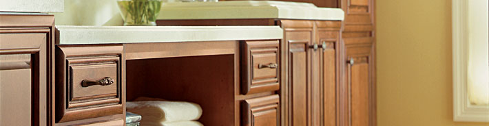 Close-up of bathroom cabinets in a medium brown stain
