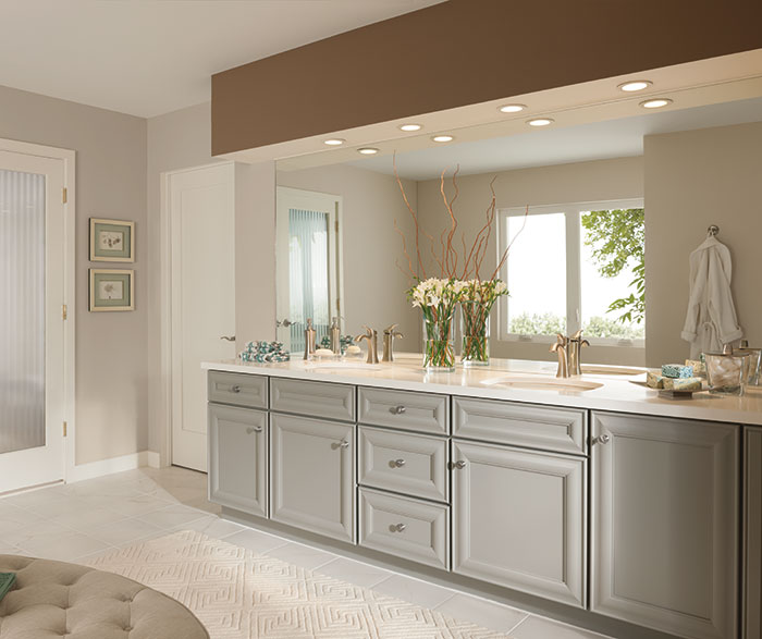 Gray bathroom cabinets by Kemper Cabinetry