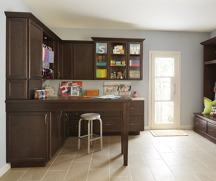 Dark Maple craft room cabinets by Kemper Cabinetry