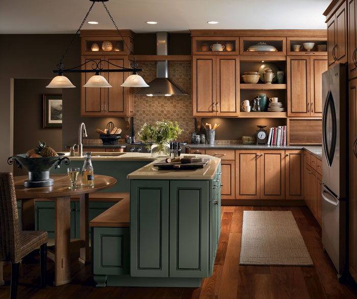 Light Maple cabinets in a casual kitchen by Kemper Cabinetry