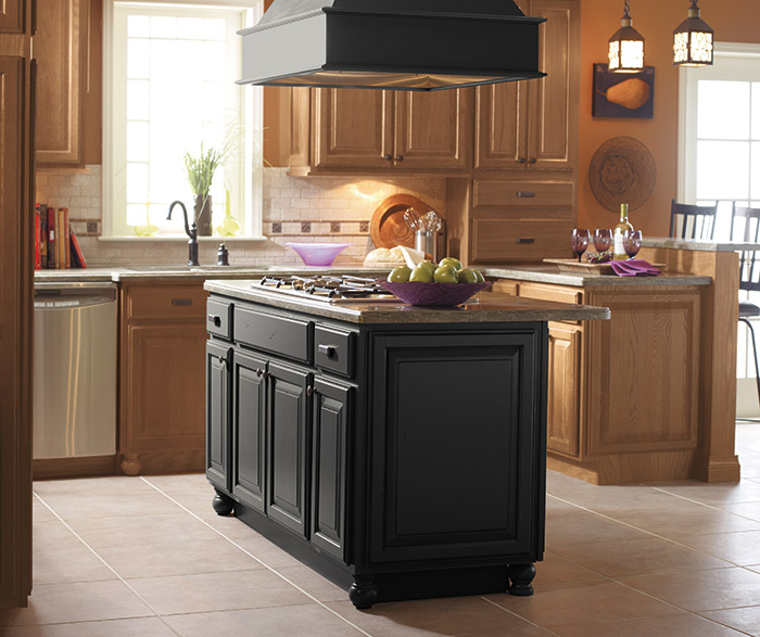 Light Oak Cabinets With A Black Kitchen Island