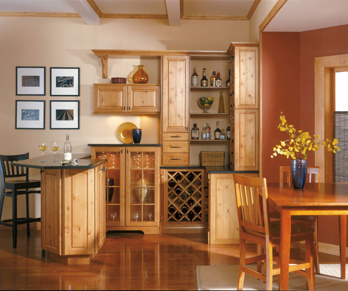 Rustic Alder cabinets in a home bar by Kemper Cabinetry