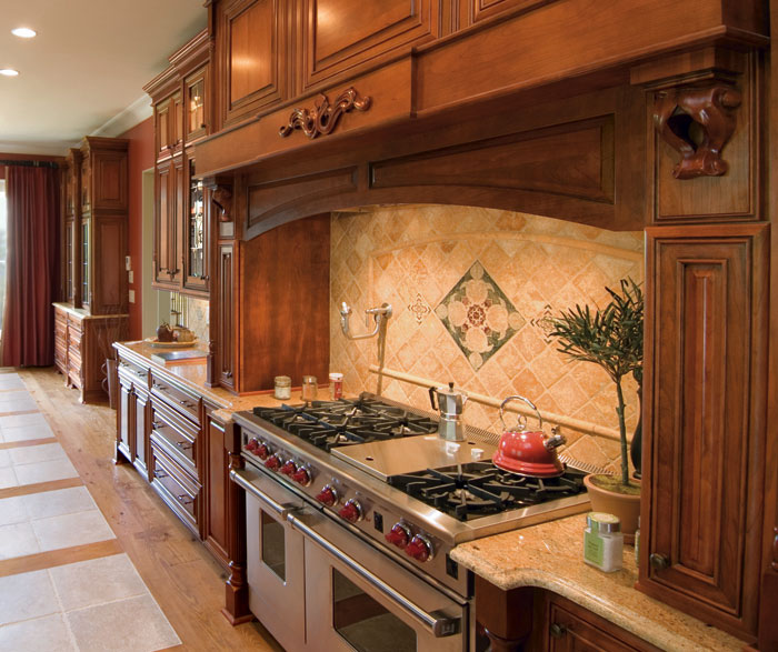 Cherry cabinets in a traditional kitchen by Kemper Cabinetry