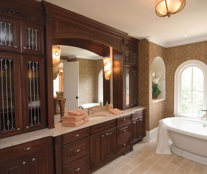 traditional bathroom with glass cabinet doors by kemper cabinetry