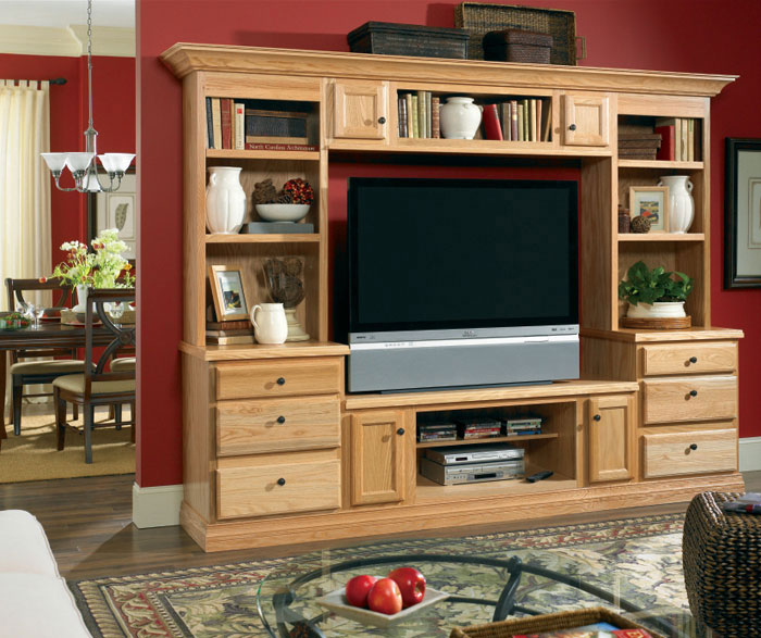 Living room storage cabinets in Natural Oak by Kemper Cabinetry