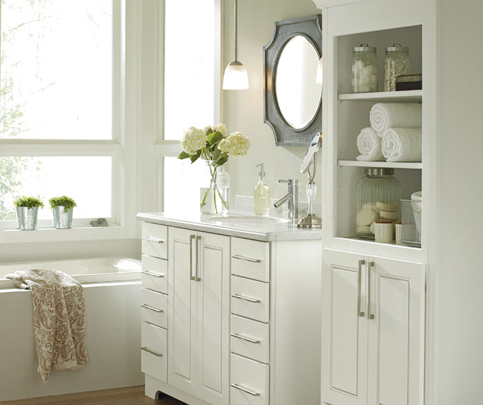 White bathroom cabinets by Kemper Cabinetry