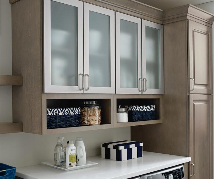 Hardin laundry room storage cabinets in Maple Seal with aluminum framed doors