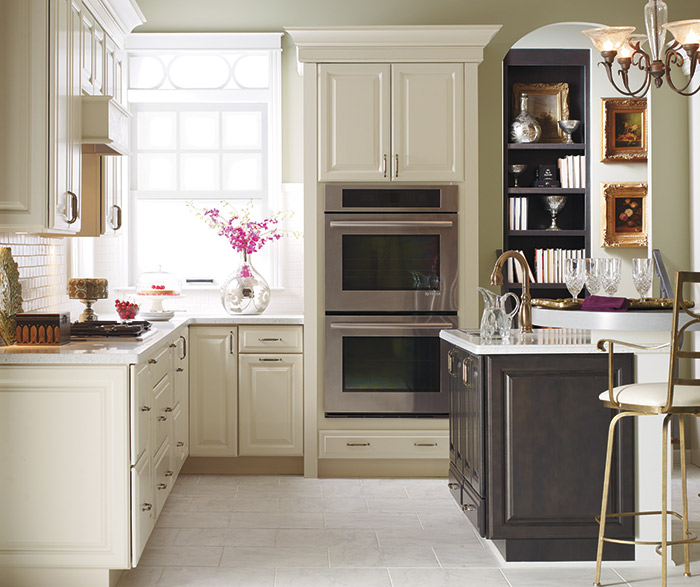 Off white kitchen cabinets by Kemper Cabinetry