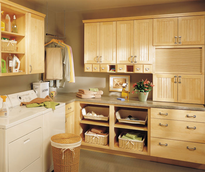 Natural maple cabinets in a laundry room by Kemper Cabinetry