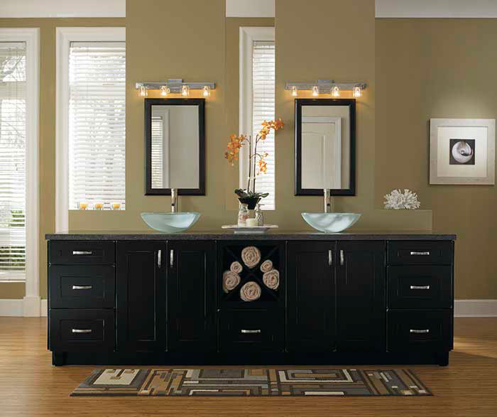Black bathroom storage cabinets by Kemper Cabinetry